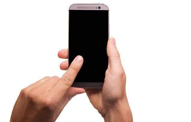 man touching phone